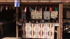 Navajo blankets being sold at roadside stand Stock Footage