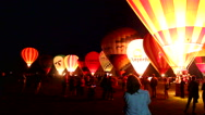Stock Video Footage of Very noisy hot air balloons making a night glow