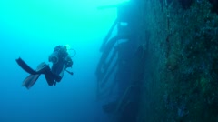 Divers exploring the side of the USS Coolidge Wreck Stock Footage