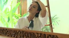 Beautiful woman drying her hair in bathroom HD Stock Footage