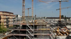 Tower cranes are working on the construction of residential building - stock footage