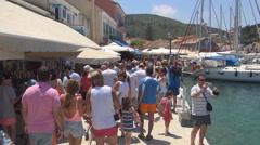 Tourists visiting souvenir shops in a island port during the summer holiday. Stock Footage