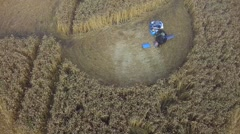 People admire a mysterious crop circle Stock Footage