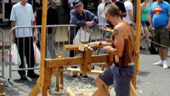Pole lathe turning demonstration. People watching and passing by. Stock Footage
