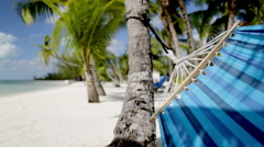 close up of hammock swinging on tropical beach - stock footage