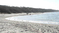 People walking along at the Baltic Sea - stock footage