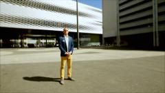 Successful businessman standing in front of business buildings. career Stock Footage