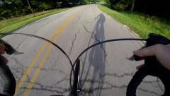 Shadow of cyclist over handlebar Stock Footage