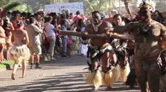 Strong men from the marquesas islands at the Tapati parade pulling wood Stock Footage