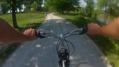 First person bike ride through a park 2 Stock Footage