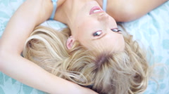 Seductive young woman in blue lingerie Stock Footage