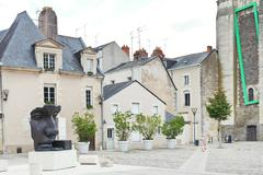 statue on rue du musee street in anges, france - stock photo