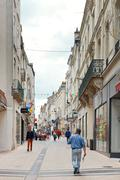 street rue baudriere in anges, france - stock photo