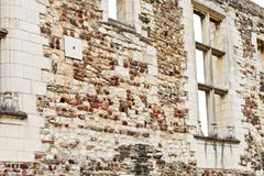 Old stone wall in angers castle, france Stock Photos