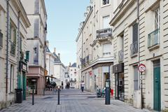 rue saint martin street in anges, france - stock photo