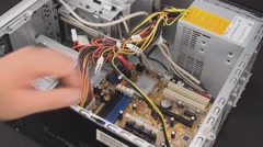 Disconnecting desktop computer psu cables 2 Stock Footage