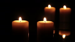 Two candles burning in front of a mirror Stock Footage