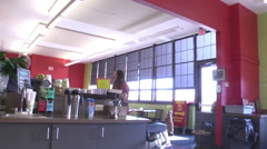 Coffee house customer coffee counter pan left WS Stock Footage