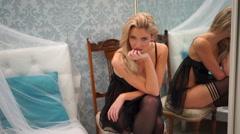 Beautiful seductive woman flirting with the camera Stock Footage