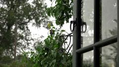 Stormy weather rain through open door window swinging in wind Stock Footage