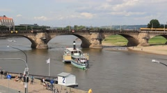 Dresden, Germany. Ship on the Elbe river and The Augustus Bridge Stock Footage
