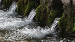 Mountain spring flowing Stock Footage
