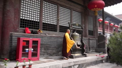 monk knocking bell in temple - stock footage