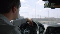 Aggresive middle-aged driver overtaking vehicle on a highway - stock footage