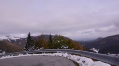 Bicyclists riding on the road. Uphill. First snow Stock Footage