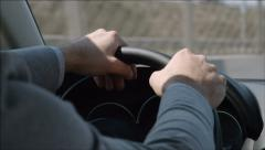 Driver turns the steering wheel aggresively - stock footage