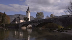 Slovenia. Bridge over the river and the church. Stock Footage