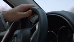 Man turns the steering wheel - Man drives a car Stock Footage