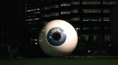 Giant Eyeball Sculture in Downtown Dallas at night Stock Footage