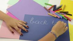 young girl write back to school - stock footage