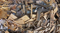 Pile Of Wood Waste Off Cuts Construction Garbage Rubbish Dump Arial Shot - stock footage