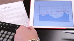 Demonstrating business infographics - stock footage
