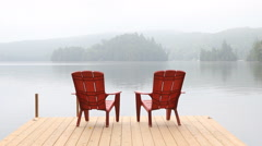 Two red chairs on dock. Misty morning. Stock Footage