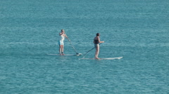Women Stand Up Paddle Boarding in the Ocean Stock Footage
