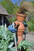 Vegetable plot scarecrow in an English garden - stock photo