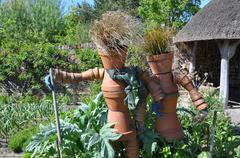 Vegetable plot scarecrows in an English garden - stock photo
