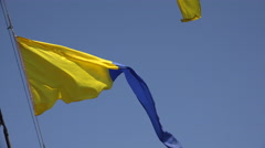 Yellow-blue ensign. A triangle. 4K. Stock Footage