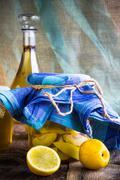 Alcohol jar quince liqueur sliced fruit prepare wooden setting Stock Photos