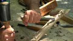 Master carves wood. 4K. Stock Footage