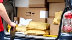 Delivery man taking package from car Stock Footage