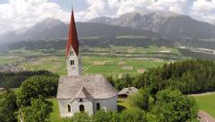 St. Peter Church with View over the Inntal - Aerial Flight Stock Footage