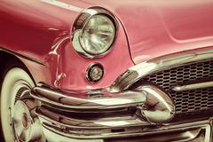 Retro styled image of a front of a classic car Stock Photos