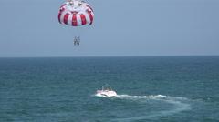 Balloon, parachute over the sea. 4K. Stock Footage