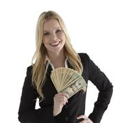 confident young businesswoman holding currency notes and smiling - stock photo