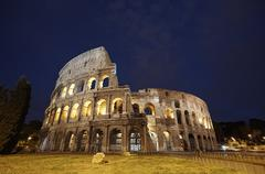 colosseum in rome, italy during sunset - stock photo