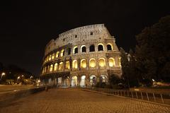 colosseum in rome, italy in the night - stock photo